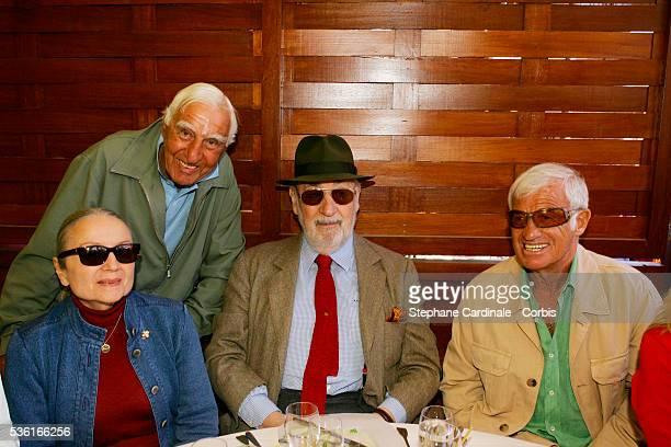 Charles Denner Philippe Noiret and his wife and JeanPaul Belmondo attend the Lacoste lunch during the Roland Garros French Open Tennis Tournament
