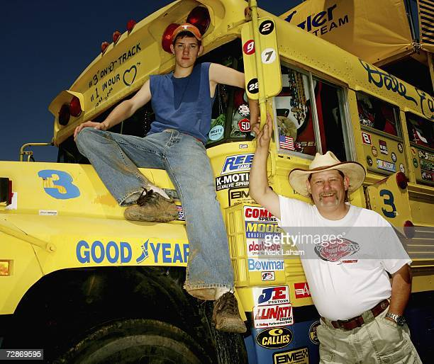 Charles Dever and his son Travis Dever of Hiram Georgia pose in front of their customized school bus decorated in full retro Dale Earnhardt...