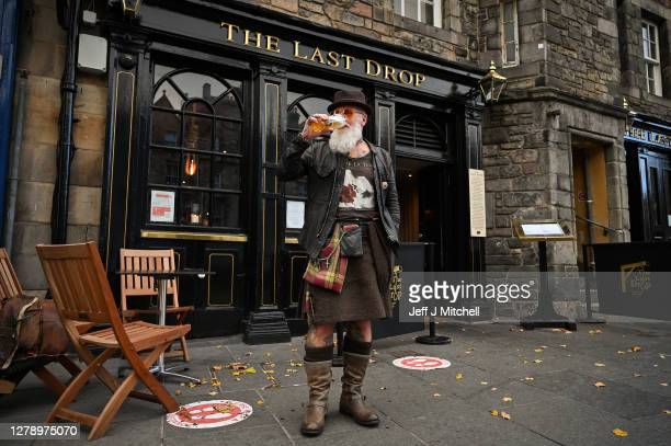 Charles Douglas Barr enjoys a pint outside The Last Drop pub in the Grassmarket on October 7, 2020 in Edinburgh, Scotland. Scottish First Minister...