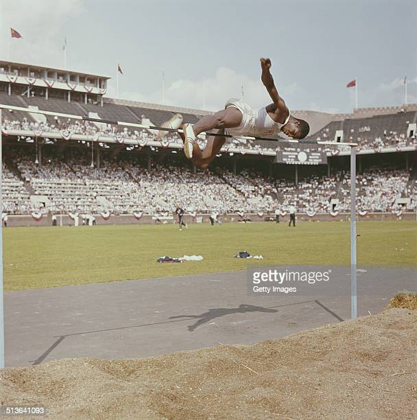 Charles Dumas of the United States winner of the High Jump Gold medal at the1956 Melbourne Summer Olympics Games competes during a USA versus USSR...