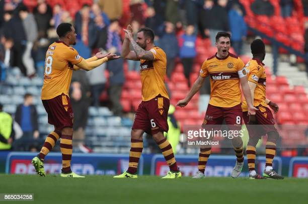 Charles Dunne Peter Hartley and Carl McHugh of Motherwell reacts at full time during the Betfred League Cup Semi Final between Rangers and Motherwell...