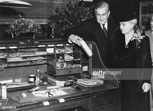 Charles E Edison an Mrs Edison, the wife and son of the late inventor Thomas Edison, viewing the great man's desk as his library is opened for the...