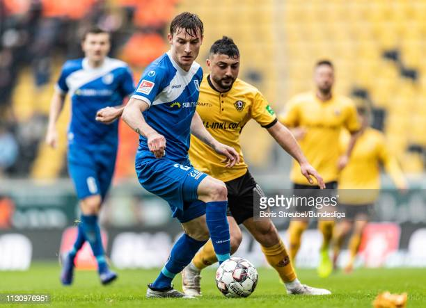 Charles Elie Laprevotte of 1 FC Magdeburg In action with Aias Aosman of Dynamo Dresden during the Second Bundesliga match between SG Dynamo Dresden...