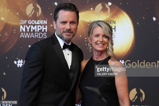 Charles Esten and Patty Hanson pose during a ceremony at the 58nd MonteCarlo Television Festival in Monaco on June 19 2018