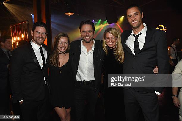 Charles Esten and Patty Hanson pose with friends during the Big Machine Label Group's celebration of the 50th Annual CMA Awards at Marathon Music...