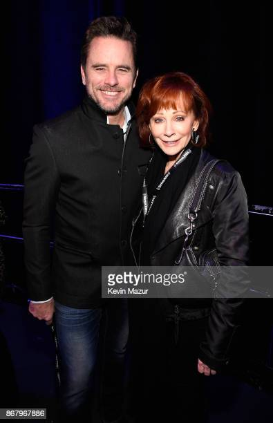 Charles Esten and Reba McEntire attend SiriusXM presents the Eagles in their first ever concert at the Grand Ole Opry House on October 29 2017 in...
