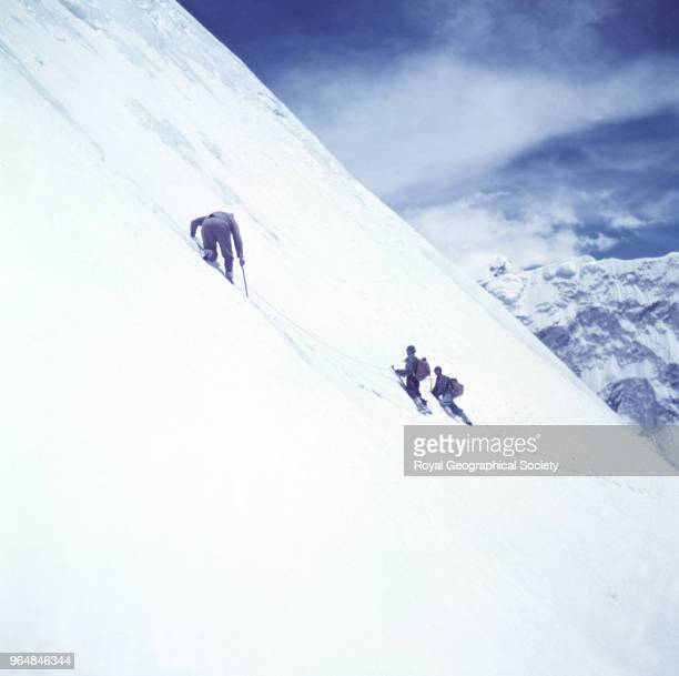 Charles Evans and porters descend after the first ascent of Island Peak On arrival in the mountains John Hunt sent off various parties to climb peaks...
