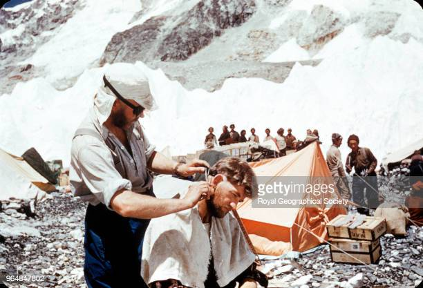 Charles Evans cutting George Lowe's hair at Base camp Nepal March 1953 Mount Everest Expedition 1953