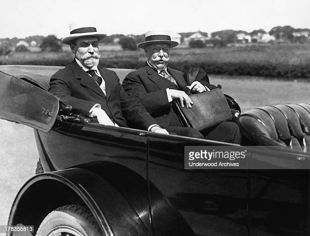 Charles Evans Hughes, the Republican candidate for President, and William Howard Taft, the former President, arrive in Hughes' car at Hughes' summer...