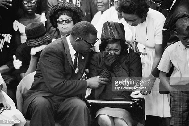 Charles Evers comforts his brother's wife at the funeral of slain civil rights leader Medgar Evers