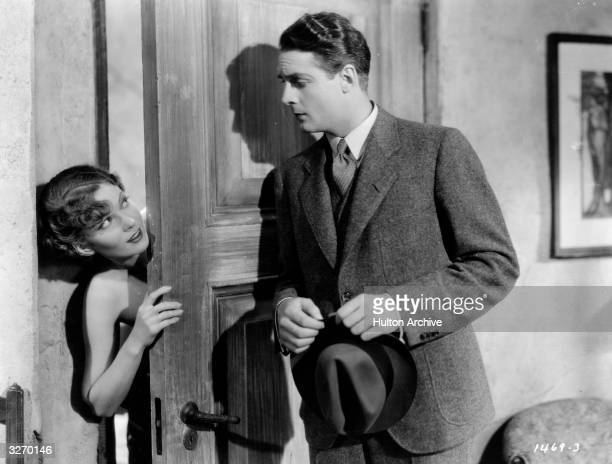 Charles Farrell and Marguerite Churchill star in the Paramount film 'Girl Without A Room'