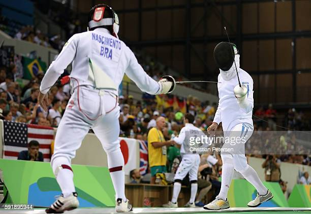 Charles Fernandez of Guatemala duels Felipe Nascimento of Brazil during the Modern Pentathlon Mens Fencing: classification round on Day 13 of the Rio...
