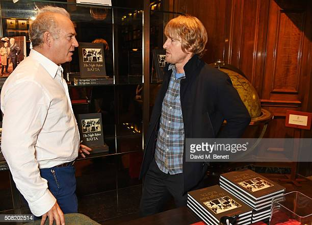 Charles Finch and Owen Wilson attend the launch of The Night Before BAFTA by Charles Finch at Maison Assouline on February 3 2016 in London England