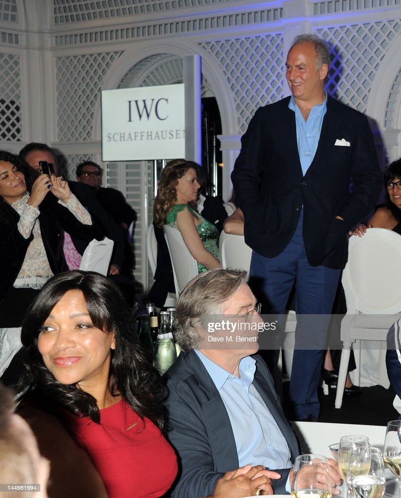 Charles Finch presents as Grace Hightower and Robert De Niro attend the IWC and Finch's Quarterly Review Annual Filmmakers Dinner at Hotel Du Cap-Eden Roc on May 21, 2012 in Antibes, France.