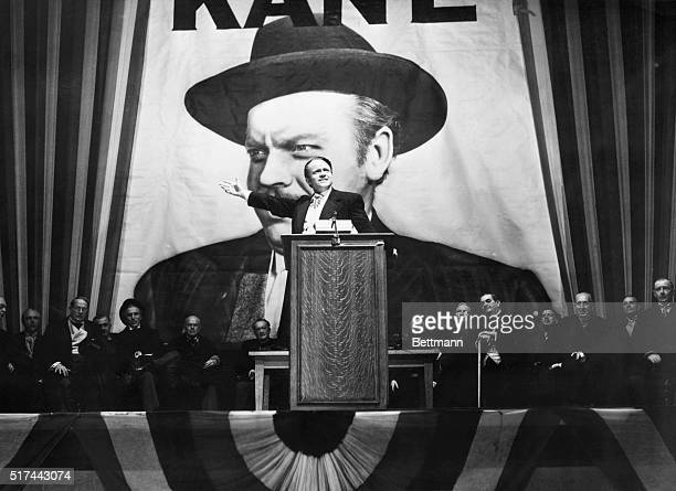 Charles Foster Kane makes a stirring campaign speech before a largerthanlife portrait of himself in a scene from Citizen Kane