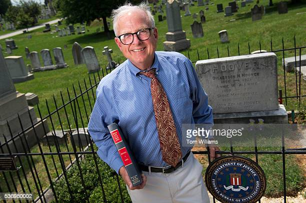 Charles Francis is photographed in front of J. Edgar Hoover's grave in Congressional Cemetery, June 1, 2016. He holds an amicus brief of Obergefell...