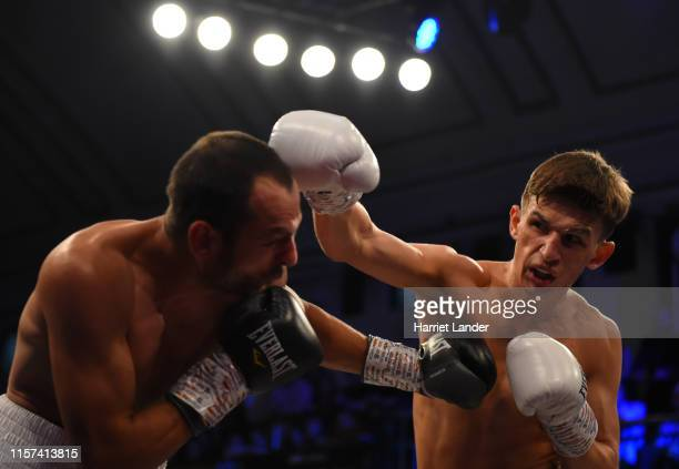 Charles Frankham punches Ilgvars Krauklis during the Lightweight fight between Charles Frankham and Ilgvars Krauklis at York Hall on June 21 2019 in...