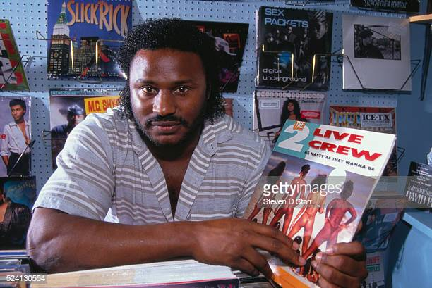 Charles Freeman holds a 2 Live Crew record sleeve depicting scantily clad women Police arrested Freeman for selling this album in his record store