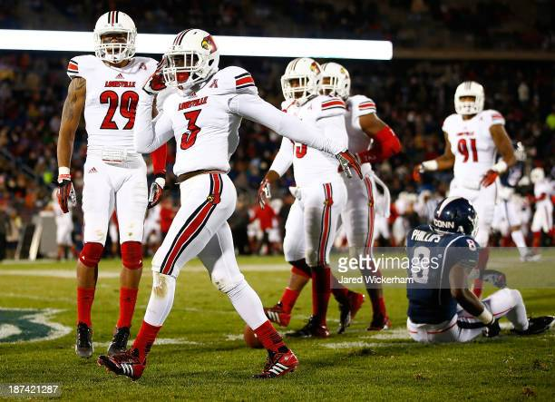 Charles Gaines of the Louisville Cardinals celebrates his interception in front of Shakim Phillips of the Connecticut Huskies at Rentschler Field...