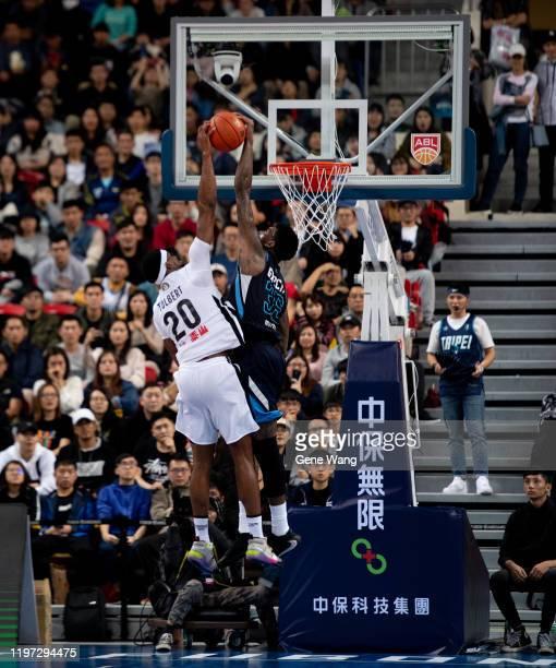 Charles Garcia of Taipei Fubon Braves blocks Jordan Tolbert of Formosa Dreamers during the ASEAN Basketball league match between Taipei Fubon Braves...