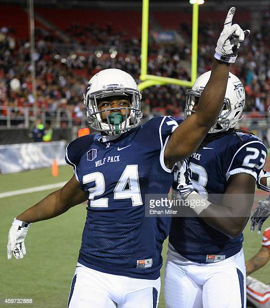 Charles Garrett of the Nevada Wolf Pack celebrates after intercepting a UNLV Rebels pass in the end zone during their game at Sam Boyd Stadium on...