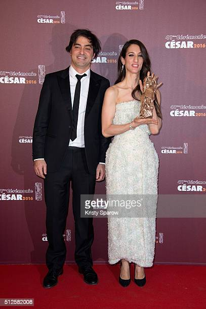 Charles Gillibert and Deniz Gamze Erguven pose with their award for Best Feature Film for the movie 'Mustang' during The Cesar Film Awards 2016 at...