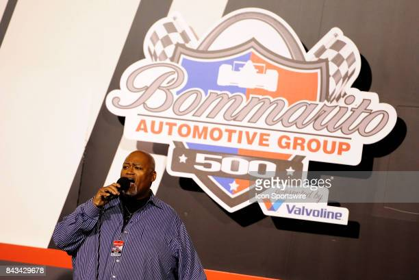 Charles Glenn sings the National Anthem before the start of the IndyCar Bommarito Automotive Group 500 on August 26 at Gateway Motorsports Park in...