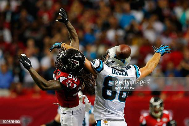 Charles Godfrey of the Atlanta Falcons breaks up a pass intended for Greg Olsen of the Carolina Panthers on fourth down during the second half at the...