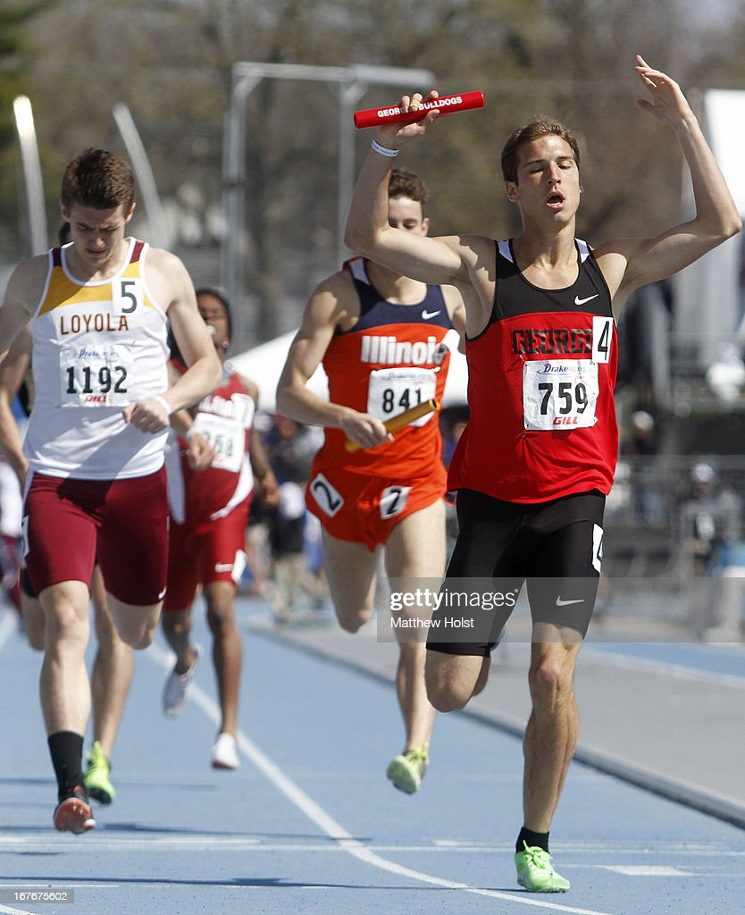 Charles Grethen, of the Georgia Bulldogs, celebrates as he crosses the finish line anchoring the Men's 1600-Meter Sprint Medley at the Drake Relays, on April 27, 2013 at Drake Stadium, in Des Moines, Iowa.