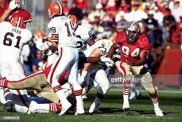 Charles Haley of the San Francisco 49ers rushes Bernie Kosar of the Cleveland Browns during an NFL football game October 28 1990 at Candlestick Park...