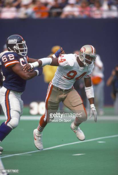 Charles Haley of the San Francisco 49ers rushes past Damian Johnson of the New York Giants during an NFL football game September 11 1988 at Giants...