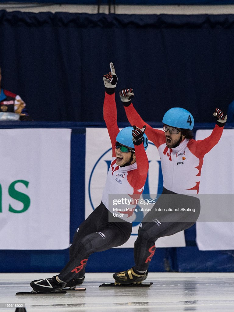 Charles Hamelin (right) and Samuel Girard (left) celebrate their finish in the men's 1000 meter final on Day 2 of the ISU World Cup Short Track Speed Skating competition at Maurice-Richard Arena on November 1, 2015 in Montreal, Quebec, Canada.