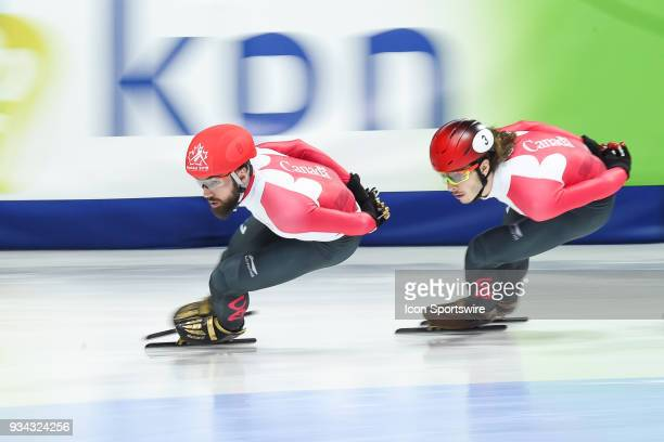 Charles Hamelin leads the race over Samuel Girard during the 1000m Final A at ISU World Short Track Speed Skating Championships on March 18 at...