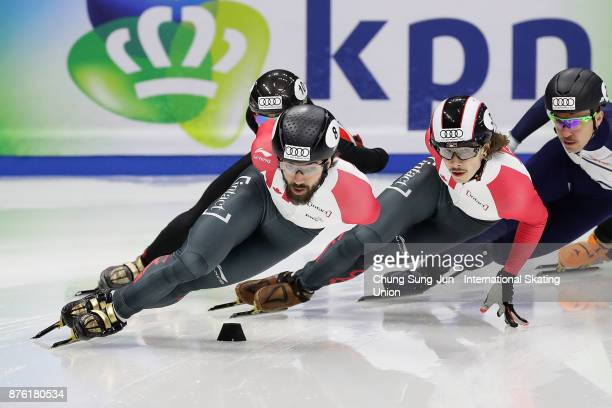 Charles Hamelin of Canada and Samuel Girard of Canada compete in the Men 1000m Semifinals during the Audi ISU World Cup Short Track Speed Skating at...