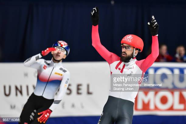 Charles Hamelin of Canada celebrates as he finishes first in the men's 1000 meter Final during the World Short Track Speed Skating Championships at...