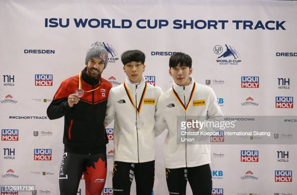 Charles Hamelin of Canada celebrates winning the second place Kim Gun Woo of Republic of Korea celebrates winning the first place and Lim Hyo Jun of...
