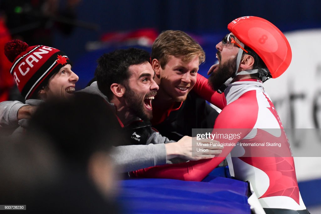 Charles Hamelin of Canada celebrates with brother Francois Hamelin and Pascal Dion in the men's 3000 meter SuperFinal during the World Short Track Speed Skating Championships at Maurice Richard Arena on March 18, 2018 in Montreal, Quebec, Canada.