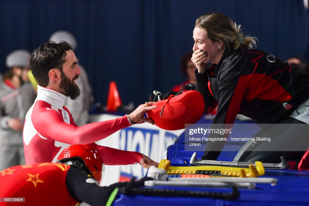 Charles Hamelin of Canada celebrates with Marianne St-Gelais of Canada after becoming the overall champion in the men's 3000 meter SuperFinal during the World Short Track Speed Skating Championships at Maurice Richard Arena on March 18, 2018 in Montreal, Quebec, Canada.