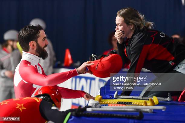 Charles Hamelin of Canada celebrates with Marianne St-Gelais of Canada after becoming the overall champion in the men's 3000 meter SuperFinal during...