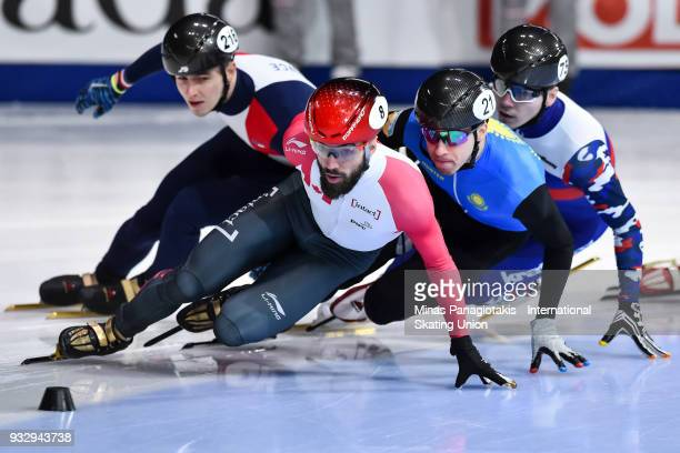 Charles Hamelin of Canada competes against Denis Nikisha of Kazakstan Denis Ayrapetyan of Russia and Dmitry Migunov of France in the men's 1500 meter...