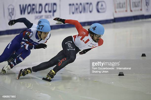 Charles Hamelin of Canada competes against Dmitry Migunov of Russia on Day 2 of the ISU World Cup Short Track Speed Skating competition at MasterCard...
