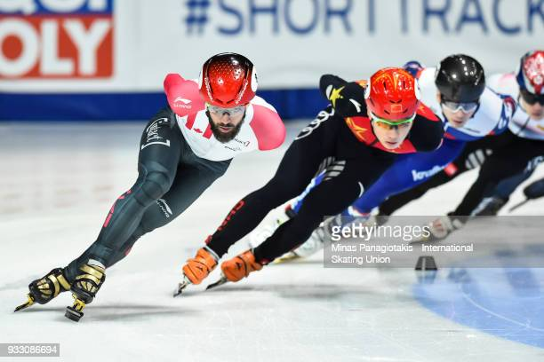 Charles Hamelin of Canada competes in the men's 1500 meter semifinals during the World Short Track Speed Skating Championships at Maurice Richard...