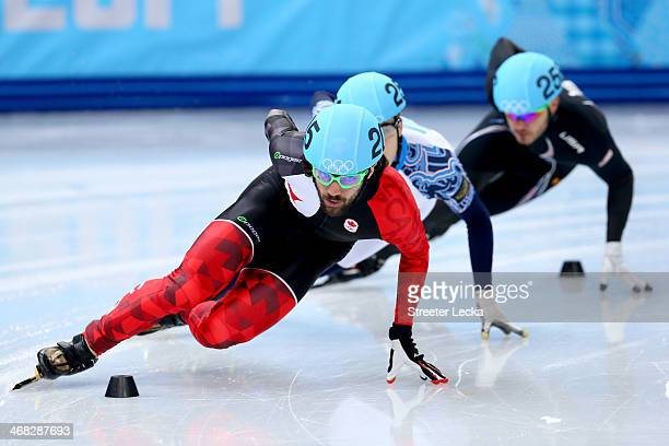 Charles Hamelin of Canada competes in the Short Track Speed Skating Men's 1500m qualifying on day 3 of the Sochi 2014 Winter Olympics at Iceberg...