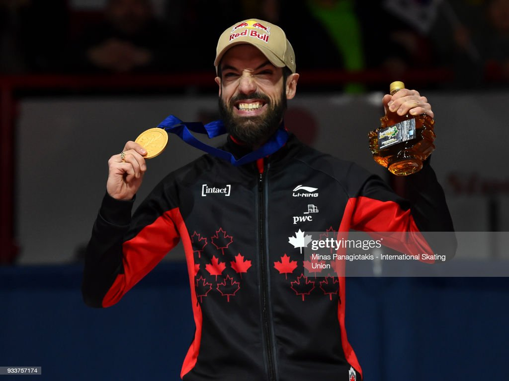 Charles Hamelin of Canada holds up his gold medal after finishing first in the men's 1000 meter Final during the World Short Track Speed Skating Championships at Maurice Richard Arena on March 18, 2018 in Montreal, Quebec, Canada.
