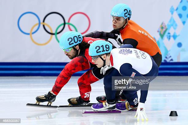 Charles Hamelin of Canada Jack Whelbourne of Great Britain and Sjinkie Knegt of Netherlands compete in the Short Track Men's 1500m Semifinal on day 3...