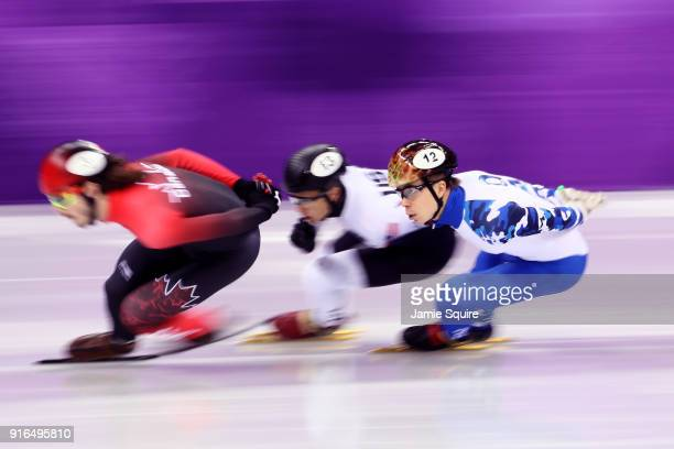 Charles Hamelin of Canada leads JR Celski of the United States and Semen Elistratov of Olympic Athlete from Russia during the Men's 1500m Short Track...