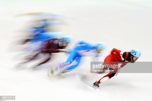 Charles Hamelin of Canada leads the pack in the Men's 1500 m Short Track finals on day 2 of the Vancouver 2010 Winter Olympics at Pacific Coliseum on...