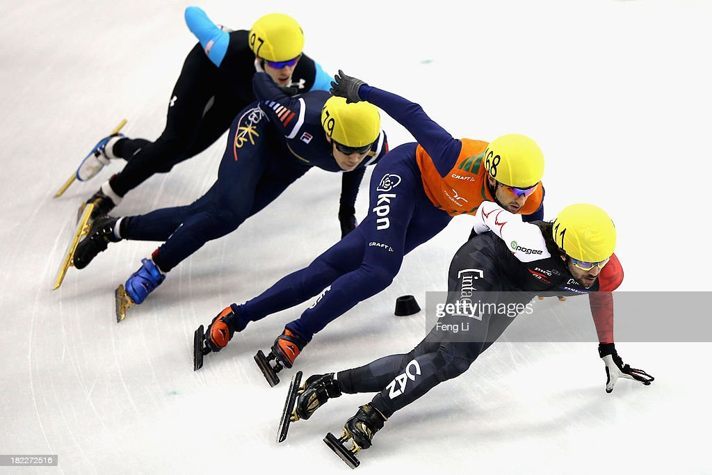 Charles Hamelin of Canada, Niels Kerstholt of Netherlands, Lee Han-Bin of Korea and Jordan Malone of United States compete in the Men's 1000m Final during day four of the Samsung ISU World Cup Short Track at the Oriental Sports Center on September 29, 2013 in Shanghai, China.
