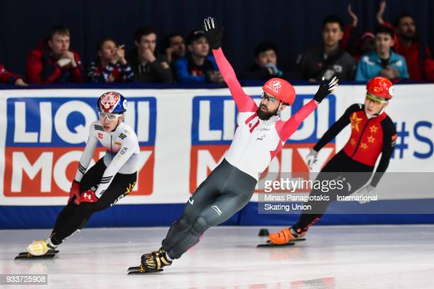 Charles Hamelin of Canada reacts after becoming the overall champion in the men's 3000 meter SuperFinal during the World Short Track Speed Skating...