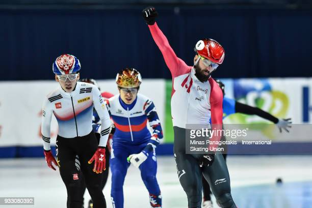 Charles Hamelin of Canada reacts after finishing first in the men's 1500 meter finals during the World Short Track Speed Skating Championships at...
